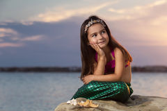 Little girl on the beach in summer Royalty Free Stock Image