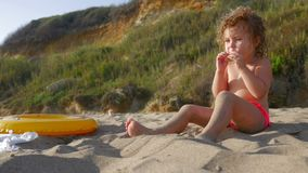Little girl on the beach, sunset and sand stock footage