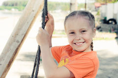 Little girl on the beach on a swing. Close up portrait royalty free stock photo
