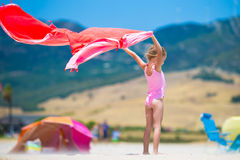 Little girl with beach towel during tropical Royalty Free Stock Photography