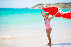 Little girl with beach towel during tropical Royalty Free Stock Images