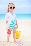 Little girl with beach toys. Adorable little girl with beach toys on vacation Stock Photography