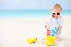Little girl with beach toys. Adorable little girl with beach toys on vacation Royalty Free Stock Photography