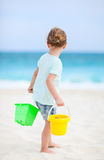 Little girl with beach toys Stock Images