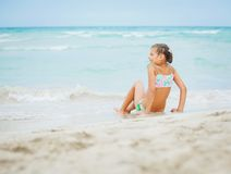 Little girl on beach vacation Stock Photos