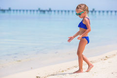 Little girl beach vacation Stock Images