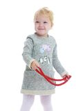 Little girl with beads in their hands Royalty Free Stock Photos
