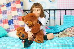 Little girl with bear cub Royalty Free Stock Photography