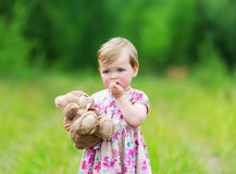 Little girl and bear Teddy. Stock Image