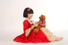 Little girl with bear toy stock images