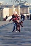 Little girl bears down the street Stock Image