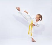 Little girl beats high blow leg Yoko geri Royalty Free Stock Images