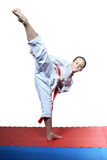 Little girl beats roundhouse kick leg Royalty Free Stock Image