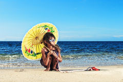 Little girl on a beautiful day at the beach Stock Photos