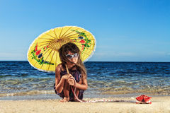 Little girl on a beautiful day at the beach Royalty Free Stock Images