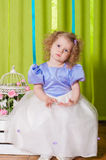 Little girl in a beautiful dress with  birdcages Royalty Free Stock Photos