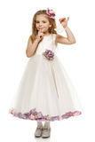 Little girl in beautiful dress holding bells Royalty Free Stock Photography