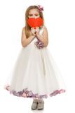 Little girl in beautiful dress holding heart shape Stock Images