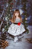 Little girl in beautiful dress sitting Royalty Free Stock Photo
