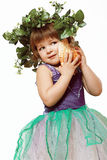 Little girl in a beautiful dress with a wreath on his head, and Stock Photo
