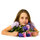 Little girl with beautiful flowers Stock Photography