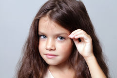 Little girl with beautiful hair Stock Image