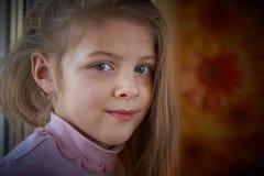 Little girl. Beautiful little girl with long hair clouseup Stock Photo