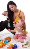 Little girl with beautiful mother Royalty Free Stock Photo