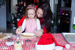 Little girl with beautiful mother baking Christmas Stock Photography