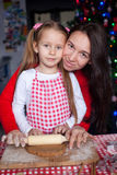 Little girl with beautiful mother baking Christmas Royalty Free Stock Images
