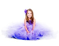 Little girl in a beautiful purple dress Stock Images