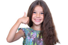 Little girl. Beautiful little girl shows finger as sign that everything is fine Royalty Free Stock Image