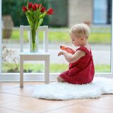 Little girl with beautiful tulips Royalty Free Stock Image