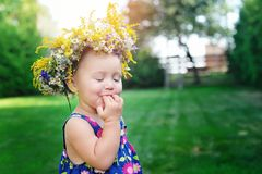 Little girl with a beautiful wreath on his head Royalty Free Stock Photos
