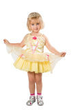Little girl in a beautiful yellow dress and crown on white back Royalty Free Stock Image