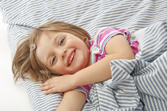 Little girl in the bed Stock Photos