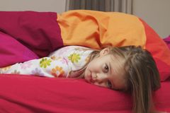 Little Girl on a Bed Royalty Free Stock Photo