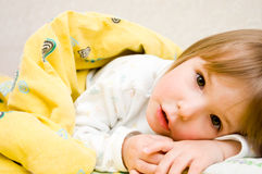 Little girl is in bed. Little girl is in a bed Royalty Free Stock Images