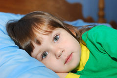 The little girl on a bed Royalty Free Stock Photo