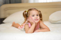 Little girl on the bed at home Royalty Free Stock Photo
