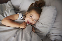 Little girl in the bed Royalty Free Stock Images