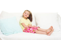 Little girl in bed. Isolated royalty free stock photos