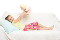 Little girl in bed. Isolated stock image