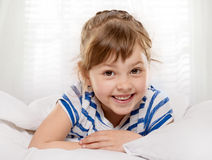 Little girl in the bed Stock Images
