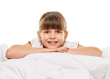 Little girl in the bed Royalty Free Stock Photos
