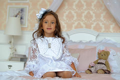 Little girl  on a bed with teddy bear Royalty Free Stock Photo