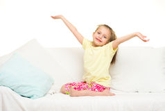 Little girl in bed. White background royalty free stock images