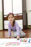 Little girl bedaubed with bright colors Royalty Free Stock Images