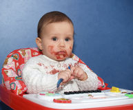 The little girl bedaubed with food Stock Photography