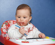 The little girl bedaubed with food Royalty Free Stock Image